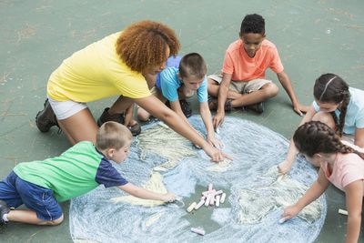 Camp counselor with children as a summer job