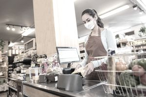 Grocery store cashier working during pandemic
