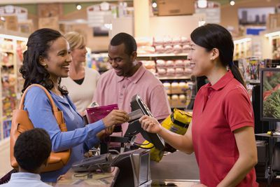 Cashier taking credit card from customer