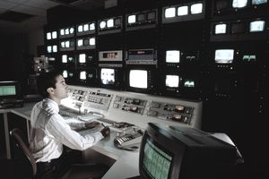 a man working in a television control room