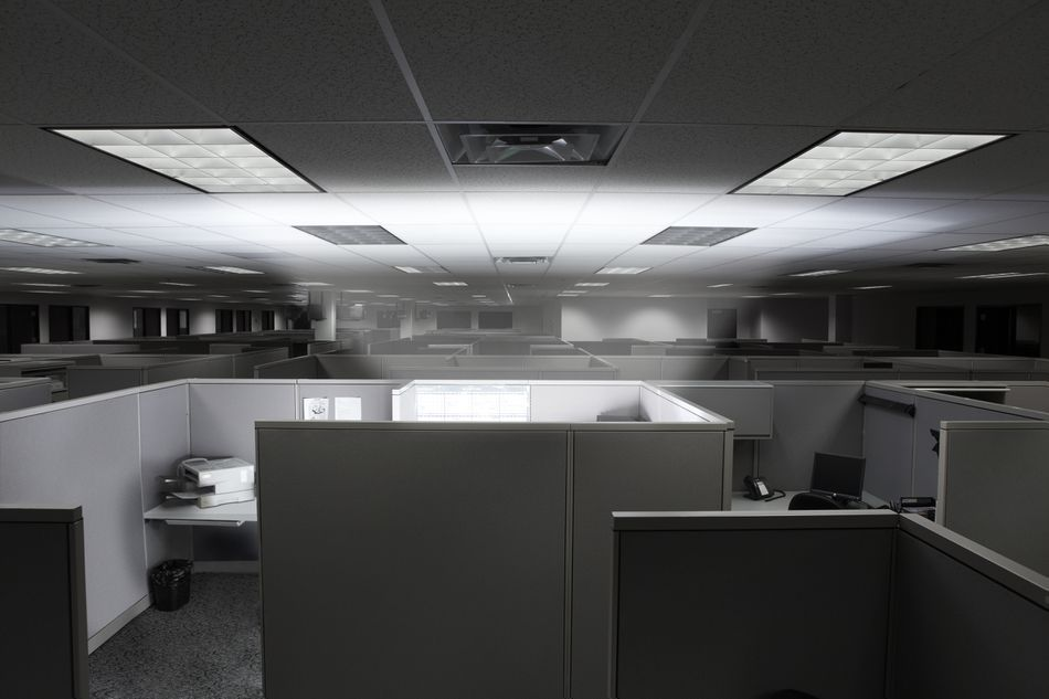 Glowing cubicle in an empty office