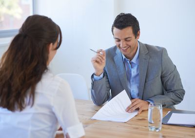 Interviewer reviewing work history on a job application
