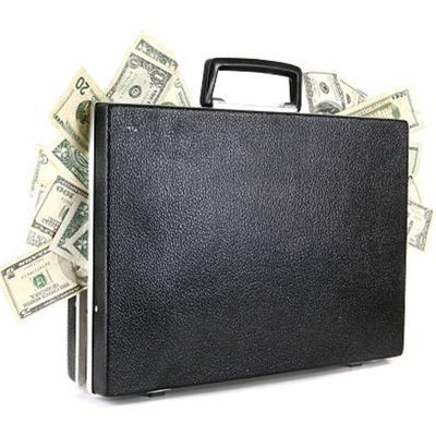 Briefcase with bills bulging out showing the rise in salaries for paralegals