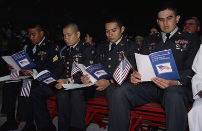 Military members at a naturalization ceremony