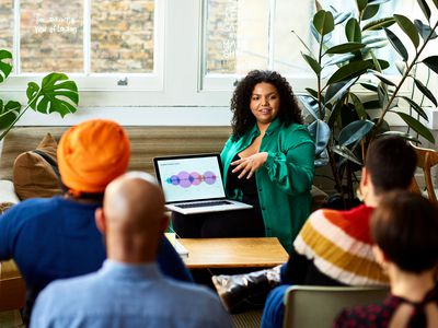 Businesswoman giving deck presentation in a meeting