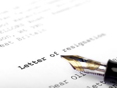 A letter of resignation with a pen on top
