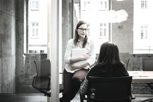 Two women talking in office