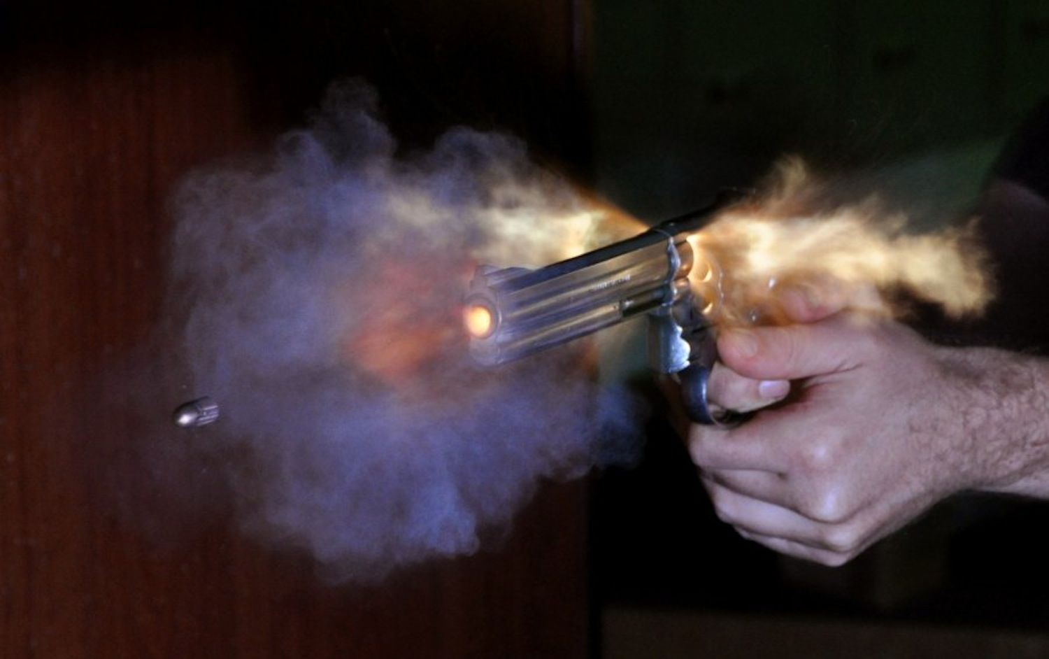 Ultra-high speed photo of bullet fired out of a S&W revolver photographed with an air-gap flash