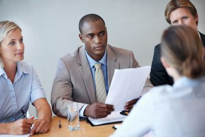 Business executives listening to the interviewee