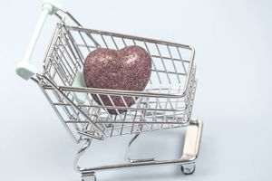 Shopping cart holding a red heart indicating health with a flexible spending account.