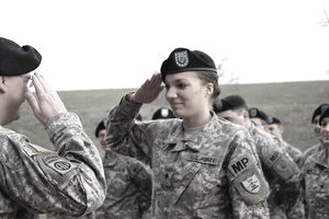 Ayana C. Hartman salutes Sgt. 1st Class Troy Skelton, both of Detachment 2 of the North Dakota Army National Guard's 191st Military Police Company, after Skelton promoted her to the rank of specialist on April 18, 2010.
