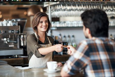 Woman working at coffee shop as a second job