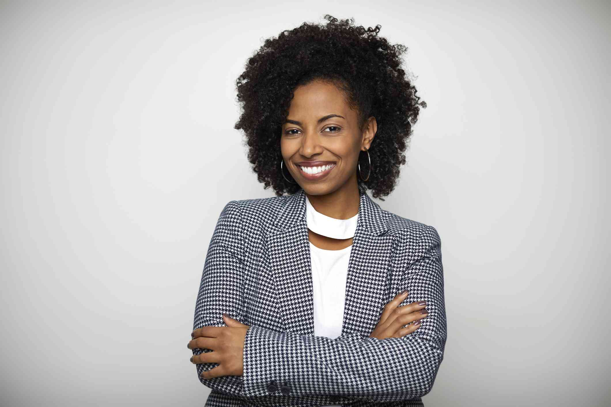 Smiling businesswoman against white background