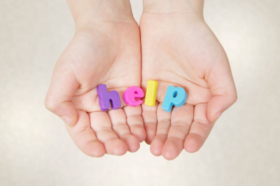child's hands with the word help in them