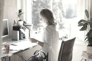 Woman job hunting in home office