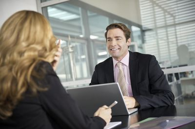 a businessman and woman conversing