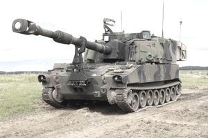 An American howitzer vehicle on a battlefield will carry an artillery cannoneer.
