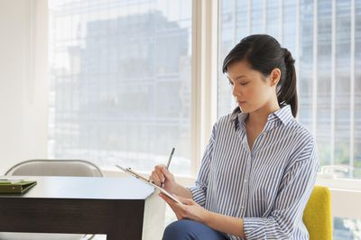 Employee sitting in an office working on a self evaluation.