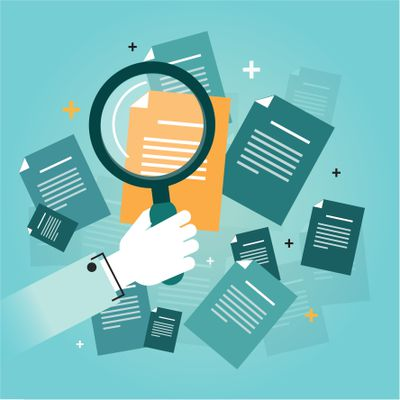 Magnifying glass and files