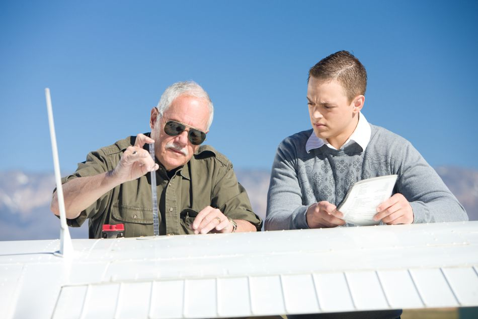 A flight instructor and student