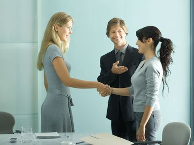 Business Professionals Meeting a New Colleague.