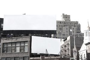 Double advertising billboard space against city buildings