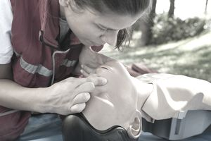 a woman taking CPR training course