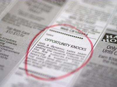 Classified advertisement for a Sales position circled in a newspaper by a job hunter.