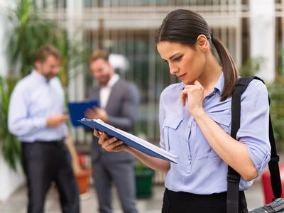 Business reviewing clipboard of job openings