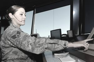 Air Force air traffic controller at work in a control tower.