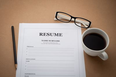 resume on office desk - How To Build A Resume
