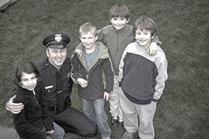 police officer posing with kids