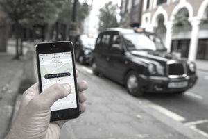 Uber urges travelers to compare its fares with taxi services.