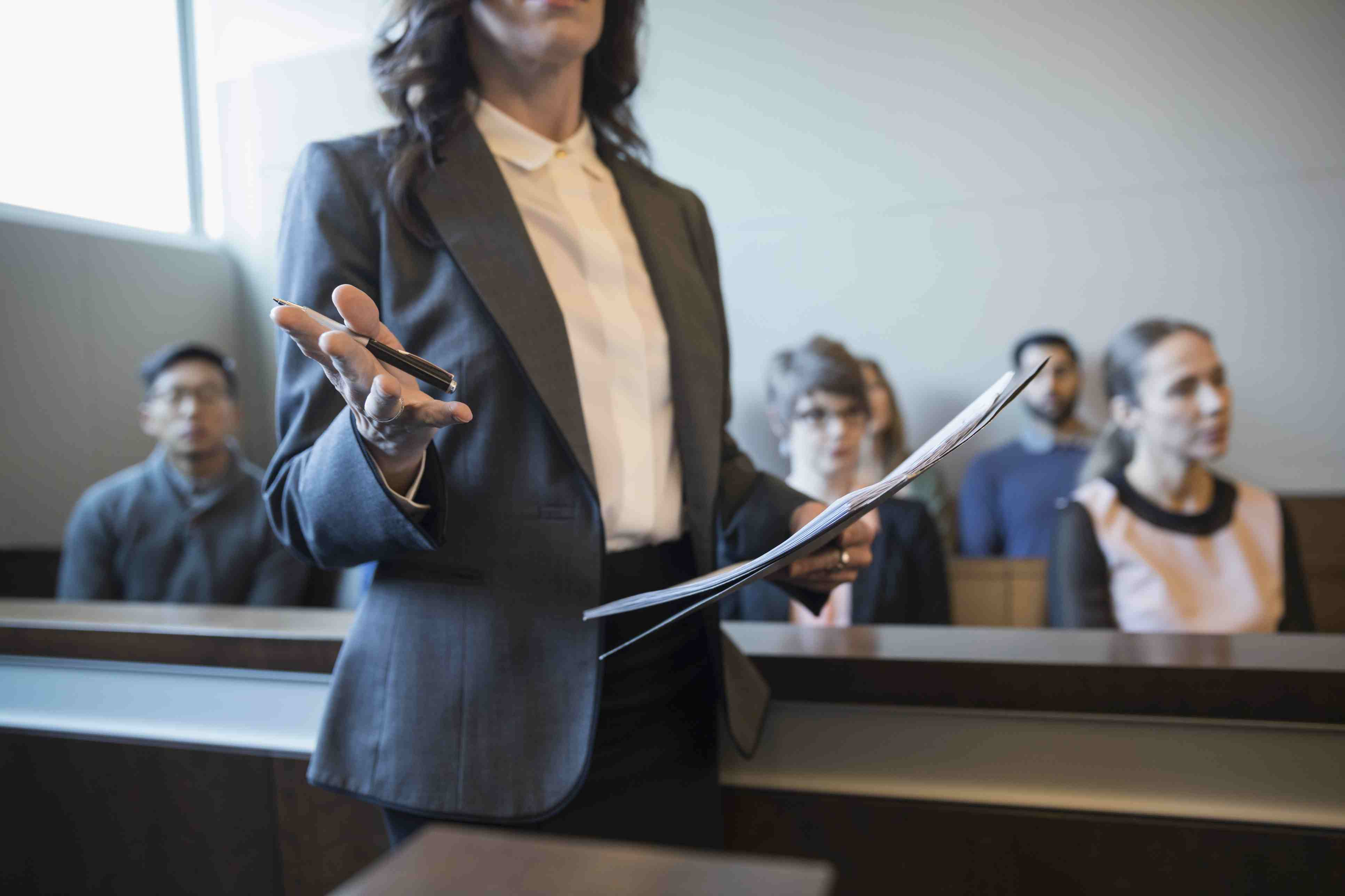 Female attorney talking and gesturing in legal trial courtroom