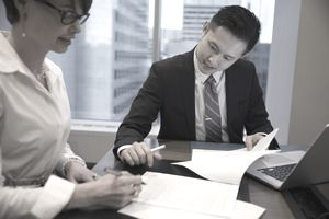 Lawyers reviewing and discussing contract in conference room meeting