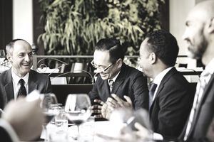 Group of laughing businessmen at lunch meeting