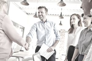 Business people in office shaking hands