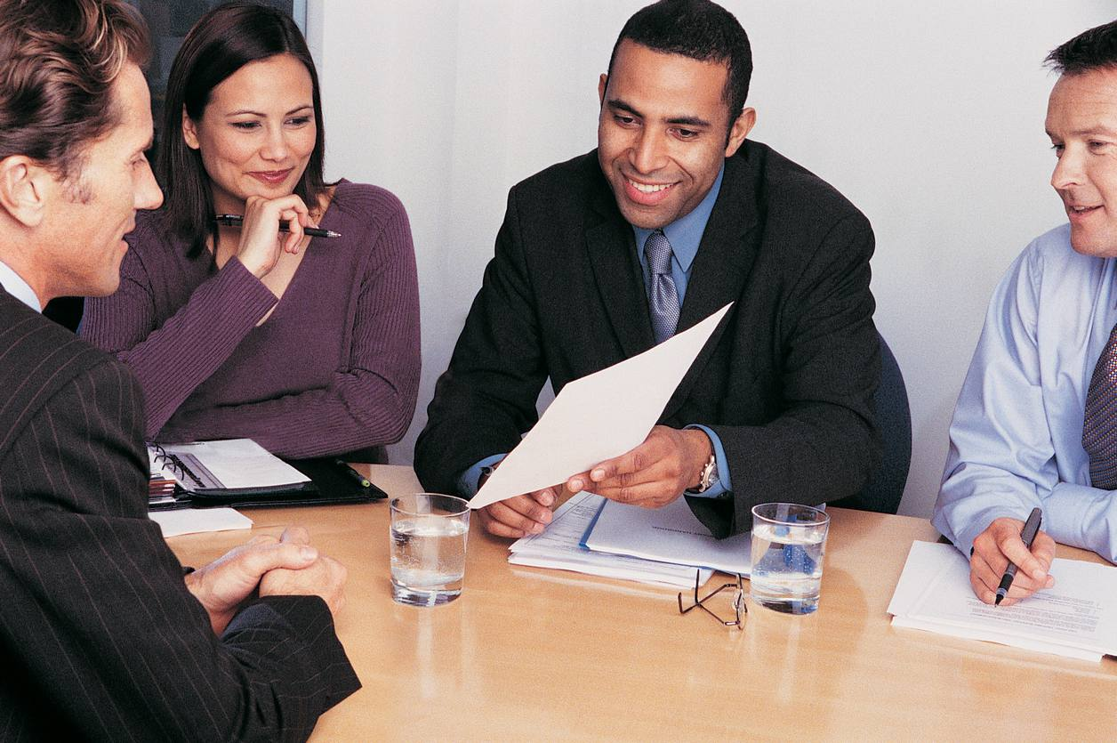 Three Business Colleagues Interviewing a Businessman to ensure that the facts on the resume are correctly stated, another interview red flag employers need to watch.