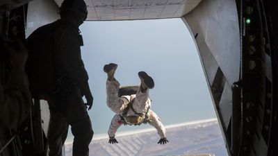 U.S. Marine parachute jumps out the back of an aircraft.