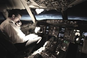 Pilot in cockpit at night