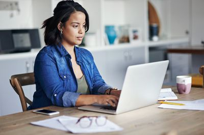 Woman sending email from home