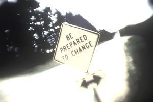 Slightly distorted sign that reads, Be Prepared to Change