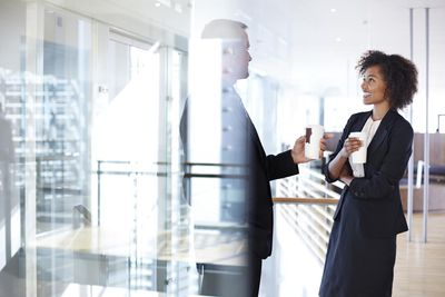 Business people having casual meeting with coffee : Stock Photo View similar imagesMore from this photographerDownload comp Caption:Corporate business people, modern architecture Business people having casual meeting with coffee
