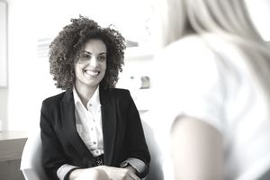A woman talks with a female applicant