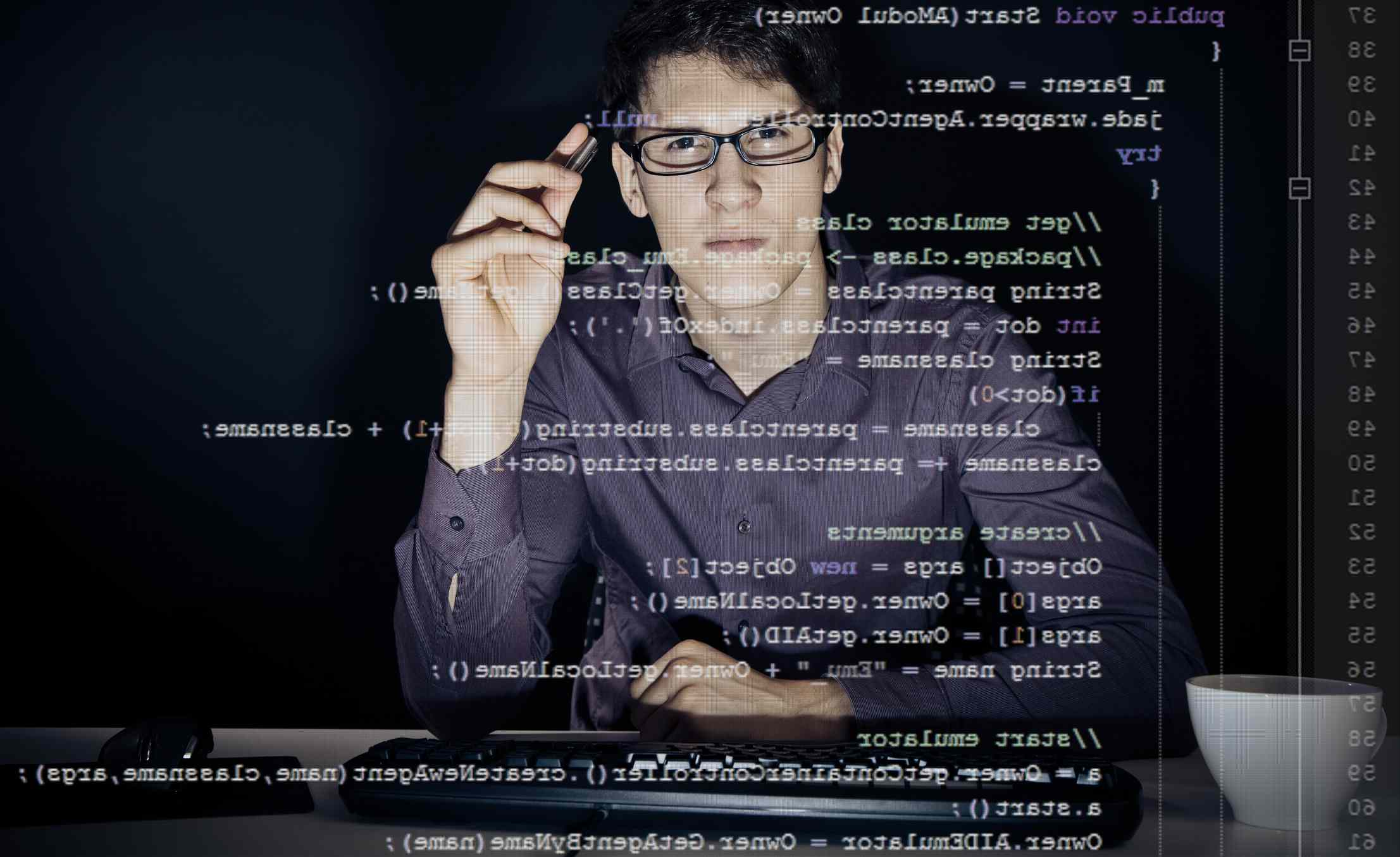 compter programmer looking through lines of code