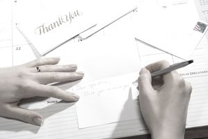 Woman writing thank youcard