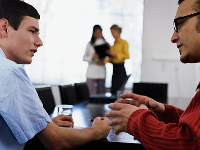two businessmen having discussion