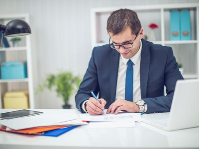Man signing cover letter