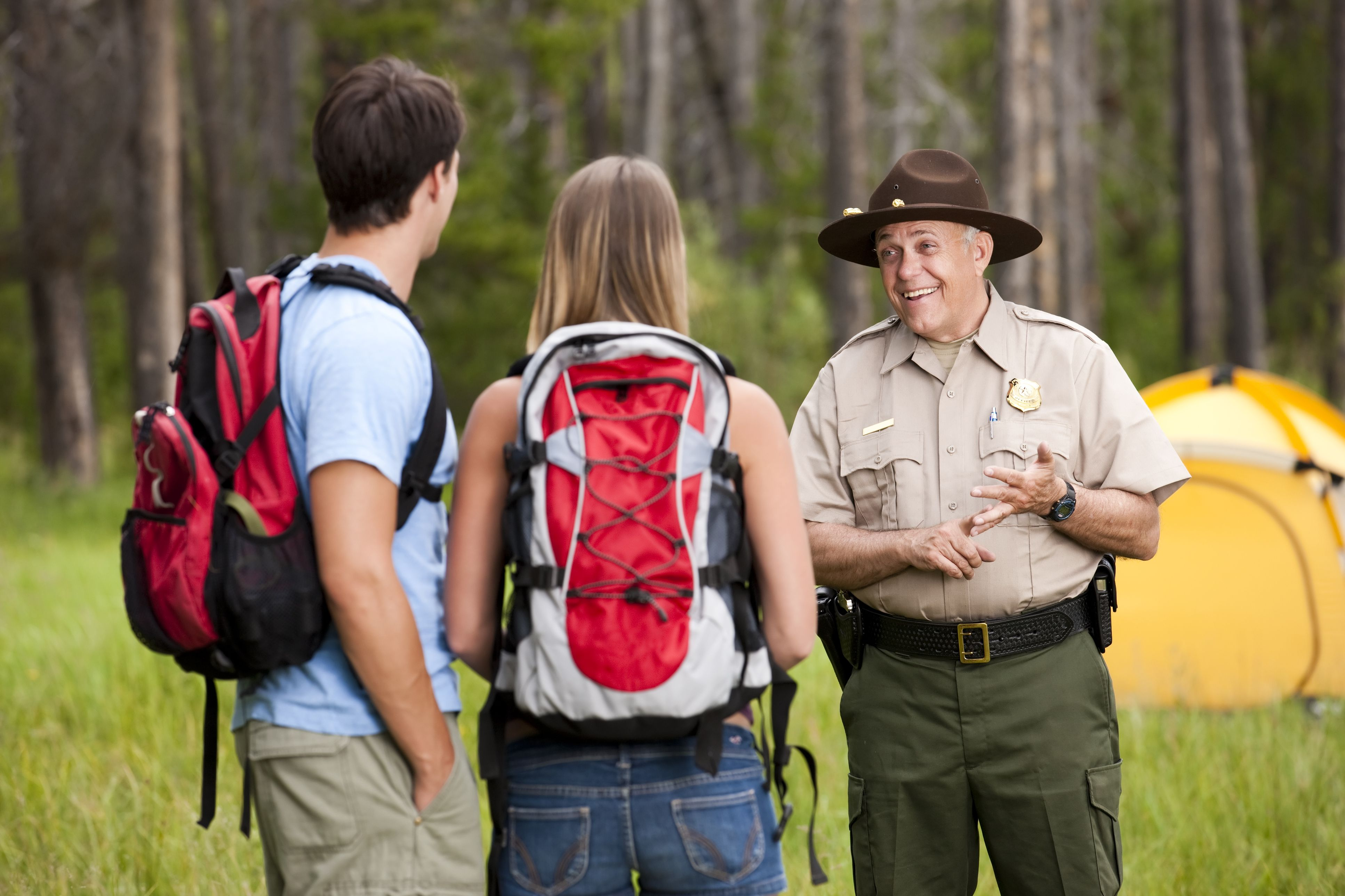 A national park service ranger talks to campers.