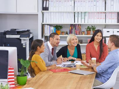 Happy employees hold meetings with each other that are always positive.